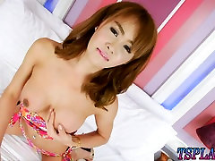 Stunning red haired tranny Barbara strokes her hard dick