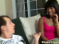 Ebony beauty wanks and sucks white cock