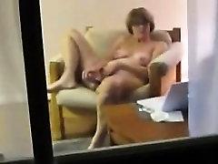 Voyeuring mum Diana toying in the living room