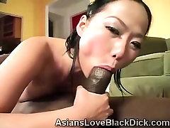 Little Asian enjoys a juicy feast of huge black meat