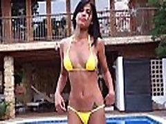 Denise Gomez posing in her yellow bikini