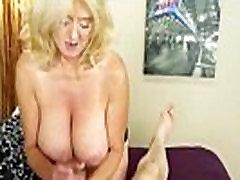 Bigtitted mature gives handjob for cumshot