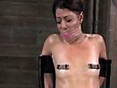 BDSM sub Mia Gold on floor hogtied