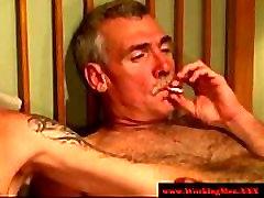Smoking gay couple tugging and fucking