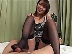 Sweet Japanese girl in stockings giving footjob and handjob