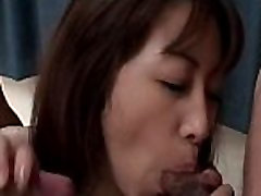 Threesomed Japanese tramp nailed from behind sucks horny dick