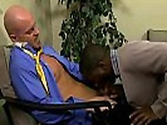 Mature muscular stud shoves his cock in a black guy