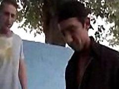 Two dudes having bareback hardcore sex in public park