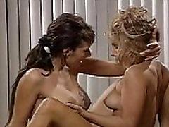 Two hot lesbians tribbing on a desk