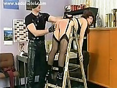 Slave in wearing latex panties gets spanked on her well formed butt