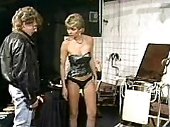 Naughty slave with great body and nice tits got her pussy lips pierced by a dominatrix