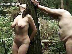 Hot bollywood nasha men tied to a tree with weights on her pierced pussy lips gets clamps on her nice tits