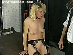 Horny slave lying on a table fucks herself with a dildo, plays with her clit