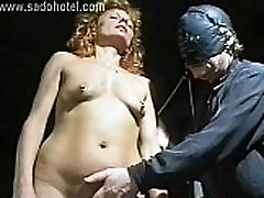 German master removes needles from sad force her body and uses a candle to drop hot wax on her tits
