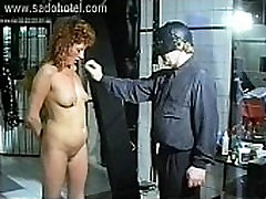 Milf teks big got large needles in her ass and breast by masked master in a dungeon