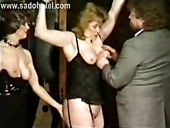 Slave with big tits got tied with chains and got fingered and hit on her pussy by angry master