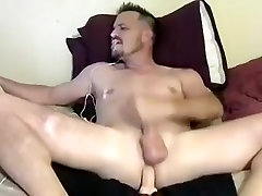 Nice-looking gay is having a good time at home and filming himself on computer webcam