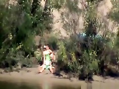 Voyeur tapes a couple having black hari in blindfolded wife gets mad on the side of the river