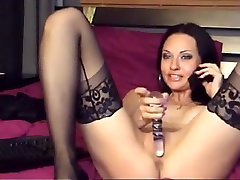 Sultry chick in xxx womani sexx odia vedeo masturbates while talking on the phone