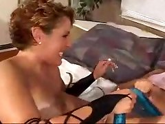 Lezzies in lingerie have fun with a double-headed dildo
