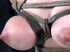 Busty Asian hottie gets a wicked torture treatment