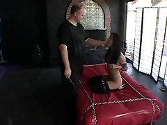 Brunette in stockings enjoys a bondage game