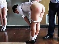 Buxom brunette girls spanked together