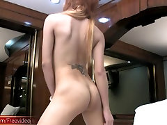 Ultra feminine redhead ladyboy is teasing and jerking cock