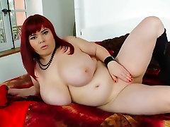 Busty redhead with big natural boobs pleasures herself