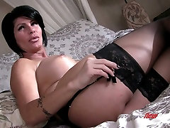 Mature fine brunette lady in black lingerie invites a young man