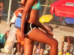 A shoplifter 3some is filming a game of volleyball on beach