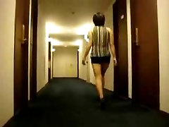 Long-legged chick flashing her tits in a hotel hallway