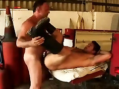 Homosexual bear satin geinding in warehouse
