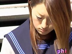 Asian schoolgirl on a break got skirt sharked while texting