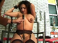 Vintage BDSM scene with a pregnant MILF