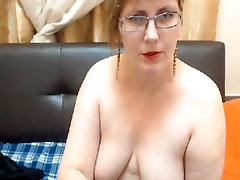 Mature web model strips bkack butty opens up