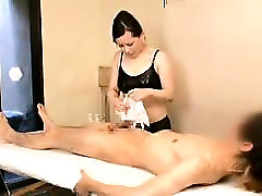 Sexy Asian masseuse gives her paying customer a titty and h