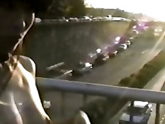 Asian girl flashes tits from bridge