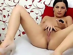 Sexy stripteasing brunette on webcam fingering her pussy and teasing