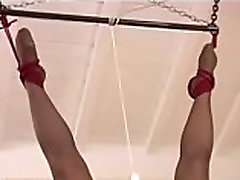Suspended girl gets toyed with.