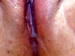 My busty oily babe eating cum pushing cum out of her pussy