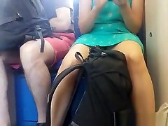 Woman in dress upskirted in train