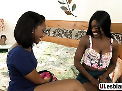 Ebony lesbians pleasing cunts with toy and tongues