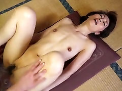 Pleasing small titted Japanese mom giving an amazing handjob