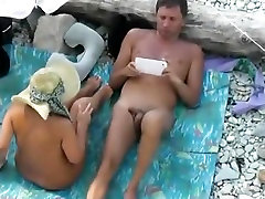 Naked man fingers his nude wife's pussy