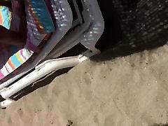 Biezā baltā laupījumu, jo sandales uz pludmali