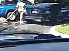 Sexy teen washing car in 2 piece bikini
