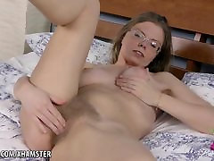 Blonde interracial mom fucker Ekaterina rubs her hairy pussy on the bed