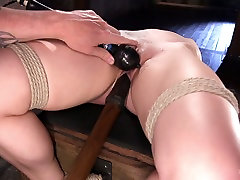 Tied up babe Dahlia Sky is punished and fucked in the dark bdsm room