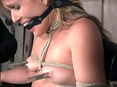 Sluttishly looking blonde Sasha Heart is tied up and punished in the helpi mam room